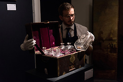 © Licensed to London News Pictures. 11/01/2018. London, UK. A Grog chest with a cased set of decanters owned by LORD HORATIO NELSON with an estimate of £35,000-£45,000. Photo credit: Ray Tang/LNP