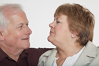 Middle-aged couple looking in eyes close-up