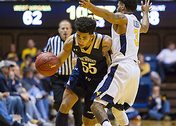 Nov 11, 2016; Morgantown, WV, USA; Mount St. Mary's Mountaineers guard Elijah Long (55) drives past West Virginia Mountaineers guard James Bolden (3) during the second half at WVU Coliseum. Mandatory Credit: Ben Queen-USA TODAY Sports