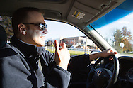 Nick Rhoades talks as he drives to an appointment with his psychiatrist in Waterloo, Iowa on Thursday, November 7, 2013.