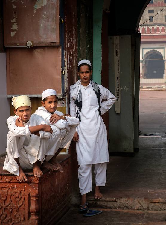NEW DELHI, INDIA - CIRCA OCTOBER 2016: Young muslim boys standing at the Fatehpuri Masjid in Old Delhi. The  mosque located at the western end of the oldest street of Delhi, Chandni Chowk.