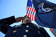 EKU ROTC Cadet Adam Renn salutes as the flag is flown at half-mast during a Veterans Day ceremony at Eastern Kentucky University, Saturday, November 10, 2012. Photo by Chris Radcliffe