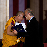 The Dalai Lama and former Nobel Peace Prize winner Elie Wiesel embrace before the Dalai Lama was awarded the Congressional Gold Medal in the Rotunda of the US Capitol Wednesday, Oct. 17, 2007. ..Photo by Khue Bui