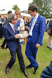 JOHN WARREN HM The Queen's Racing Manager, his wife LADY CAROLYN WARREN and their son JAKE WARREN at Goffs London Sale held at The Orangery, Kensington Palace, London on 15th June 2015.
