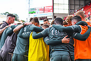Leeds United player huddle in the warm up during the EFL Sky Bet Championship match between Barnsley and Leeds United at Oakwell, Barnsley, England on 15 September 2019.