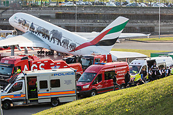 London, UK. 19th April, 2019. Police vehicles, specialist rescue vehicles and large tow trucks alongside the main motorway approach to Heathrow airport. A large policing operation was put in place in and around the airport in preparation for expected protests by climate change activists from Extinction Rebellion. Only a very small symbolic protest by teenage activists from Extinction Rebellion Youth took place, dispersed by police officers under threat of arrest.