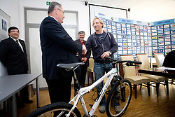 Ernest Aljancic of HZS and Tomaz Vnuk with a bike  as a present at the press conference due to the end of the career of Slovenian ice-hockey player Tomaz Vnuk,  on October 05, 2009, in Hala Tivoli, Ljubljana, Slovenia.   (Photo by Vid Ponikvar / Sportida)