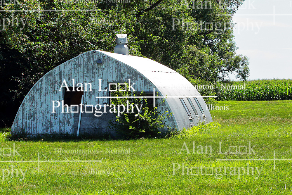 an abandoned Quonset hut type of a coop on a deserted barn lot