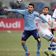 NEW YORK, NEW YORK - March 18: David Villa #7 of New York City FC is challenged by Hernan Bernardello #30 of Montreal Impact during the New York City FC Vs Montreal Impact regular season MLS game at Yankee Stadium on March 18, 2017 in New York City. (Photo by Tim Clayton/Corbis via Getty Images)