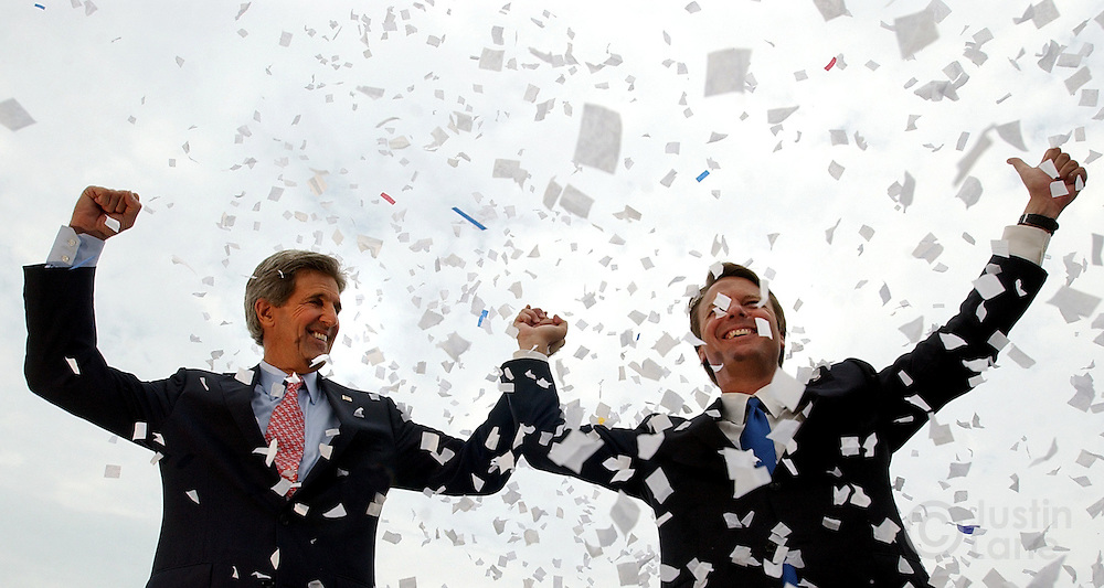 US Presidential Candidate John Kerry (L) and his new running mate John Edwards (R) acknowledges the crowd at a rally in Cleveland, OH Wednesday 7 July 2004. It was the new team's first rally together as they kick off a multi-state tour today.<br />
