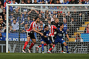 Leicester City defender Christian Fuchs (28)  has a hold of Southampton forward Graziano Pelle (19)  during the Barclays Premier League match between Leicester City and Southampton at the King Power Stadium, Leicester, England on 3 April 2016. Photo by Simon Davies.