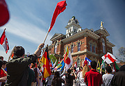 Participants wave flags at the International Street Fair 2015.