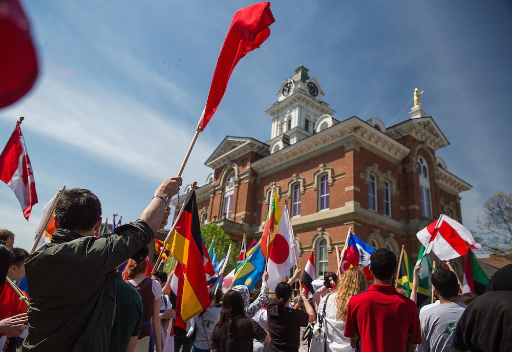 Participants wave flags at the International Street Fair 2015.