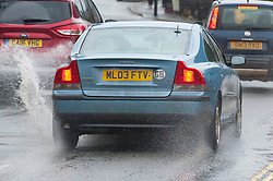 © Licensed to London News Pictures. 16/01/2020. Builth Wells, Powys, Wales, UK. Motorists drive through surface water from today's rainfall in Builth Wells in Powys, Wales, UK. Photo credit: Graham M. Lawrence/LNP