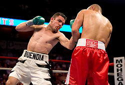 Apr 6, 2007; Uncasville, CT, USA; Juan Manuel Buendia (White trunks) and Israel Cardona (red trunks) trade punches during their 8 round ESPN2 Friday Night Fights co-featured bout.  Buendia won via 8 round unanimous decision.