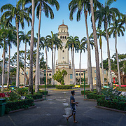 PUERTO RICO -- JANUARY  10, 2018: A student walks on the square in front of the University of Puerto Rico Theater, with the university bell tower in the background, on January 10 2018 in Rio Piedras, Puerto Rico.  The theater was the venue selected for the run of Hamilton but was replaced at the last minute due to security concerns.  <br /> (Angel Valentin / For The Times)