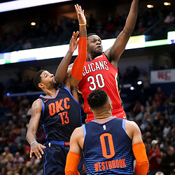 Feb 14, 2019; New Orleans, LA, USA; New Orleans Pelicans center Julius Randle (30) shoots over Oklahoma City Thunder forward Paul George (13) and guard Russell Westbrook (0) during the second half at the Smoothie King Center. Mandatory Credit: Derick E. Hingle-USA TODAY Sports