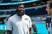 Mario Addison (DE, Carolina Panthers) interviews at the NFL Academy, Stadium showcase during the NFL Media Day held at Tottenham Hotspur Stadium, London, United Kingdom on 2 July 2019.