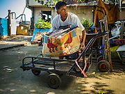 16 OCTOBER 2015 - BANGKOK, THAILAND: SAWAT TANGAON, 70, a former resident of the Wat Kalayanamit neighborhood, scavenges things his neighbors are discarding before they are evicted. Sawat was evicted from his home of more than 50 years the first week of October. Fifty-four homes around Wat Kalayanamit, a historic Buddhist temple on the Chao Phraya River in the Thonburi section of Bangkok, are being razed and the residents evicted to make way for new development at the temple. The abbot of the temple said he was evicting the residents, who have lived on the temple grounds for generations, because their homes are unsafe and because he wants to improve the temple grounds. The evictions are a part of a Bangkok trend, especially along the Chao Phraya River and BTS light rail lines. Low income people are being evicted from their long time homes to make way for urban renewal.    PHOTO BY JACK KURTZ