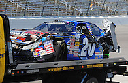 Nov. 7, 2009; Fort Worth, TX, USA; the car of Joey Logano is taken to the garage after crashing in the NASCAR Nationwide Series O'Reilly Challenge at the Texas Motor Speedway. Mandatory Credit: Jennifer Stewart-US PRESSWIRE