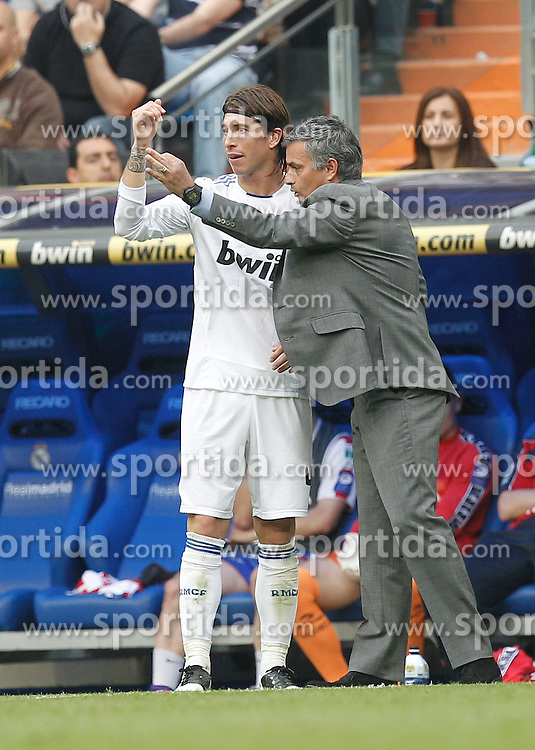02.04.2011, Estadio Santiago Bernabeu, Madrid, ESP, Primera Division, Real Madrid vs Sporting Gijon, im Bild Real Madrid's Sergio Ramos and Jose Mourino during la Liga match on March 2nd 2011. EXPA Pictures © 2011, PhotoCredit: EXPA/ Alterphotos/ Cesar Cebolla +++++ ATTENTION - OUT OF SPAIN / ESP +++++