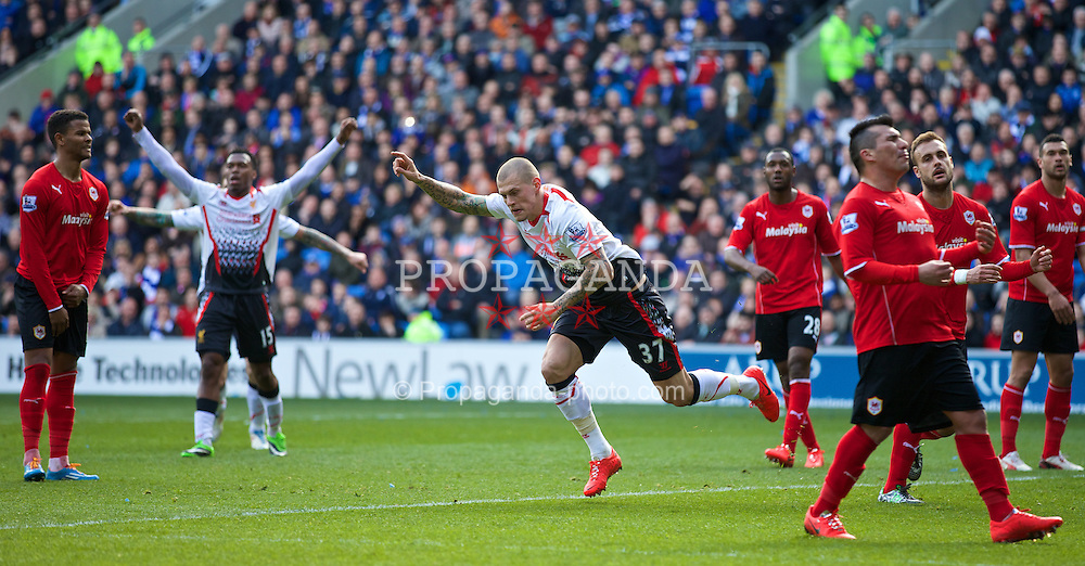 CARDIFF, WALES - Saturday, March 22, 2014: Liverpool's Martin Skrtel celebrates scoring the second goal against Cardiff City during the Premiership match at the Cardiff City Stadium. (Pic by David Rawcliffe/Propaganda)