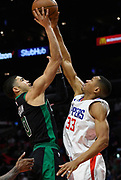 Boston Celtics forward Jayson Tatum #0 is blocked by LA Clippers forward Wesley Johnson #33 in the 2nd half. The Los Angeles Clippers were defeated by the Boston Celtics 113-102 in a regular season NBA matchup in Los Angeles, CA 1/025/2018 (Photo by John McCoy, Los Angeles Daily News/SCNG)