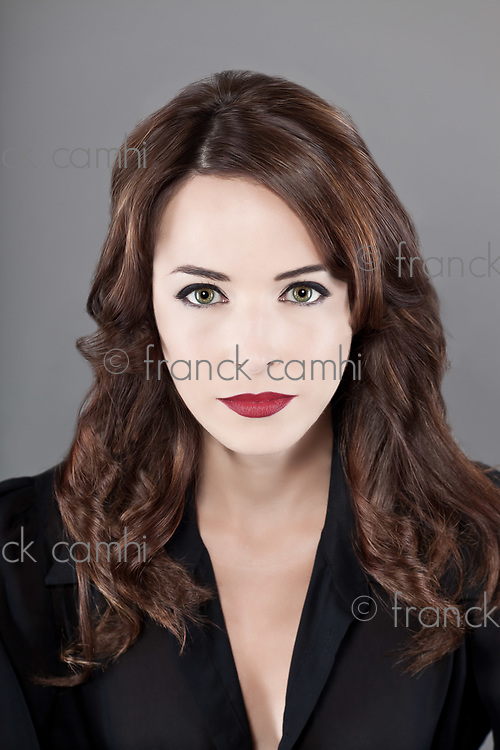 Close-up portrait of sexy middle aged woman with beautiful red lips