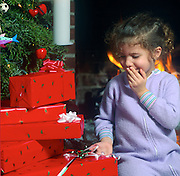 Girl with Christmas presents.