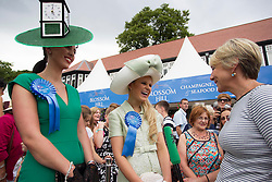 Repro Free: 08/08/2013 Suzanne O'Brien winner of the 'Most creative Hat' and Ann Marie Blenner-Hassett from Co. Dublin winner of the Blossom Hill Ladies' Day 'Best Dressed Lady' are pictured being interviewed by Tracy Piggot. Annemarie who just became a mum 8 weeks ago won an incredible trip for two to leading fashion capital New York City, Woth €8000 including €1000 spending money. Pic Andres Poveda