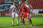 Bradford City midfielder, on loan from West Ham United, Josh Cullen (14)  and Walsall   defender James OConnor (4) wait for the delivery during the EFL Sky Bet League 1 match between Walsall and Bradford City at the Banks's Stadium, Walsall, England on 17 December 2016. Photo by Simon Davies.