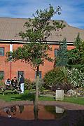 Prisoners socialising in the prison grounds. HMP The Mount, Bovingdon, Hertfordshire