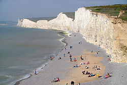 **Image shows a view from Birling gap where members of the public were standing on the cliff edge**<br /> © Licensed to London News Pictures. 22/04/2019. Birling Gap, UK.  Reckless members of the public risk their lives on the edge of the crumbling chalk cliffs of the Seven Sisters near Eastbourne, UK. The iconic sheer white cliffs are up to 400 feet high and have had recent record cliff falls due to erosion, but many people, some even holding children, cannot resist the temptation to peer over the edge to get photos. Some people are even seen jumping in the air just feet from the edge.  Photo credit: Peter Cripps/LNP