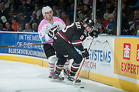 KELOWNA, CANADA - OCTOBER 14: Tyson Baillie #24 of Kelowna Rockets checks Conner Bleackley #9 of Red Deer Rebels on October 14, 2015 at Prospera Place in Kelowna, British Columbia, Canada.  (Photo by Marissa Baecker/Shoot the Breeze)  *** Local Caption *** Tyson Baillie; Conner Bleackley;