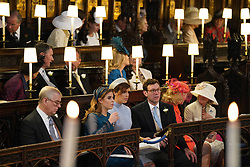 (Left to right) The Duke of York, Princess Beatrice, Princess Eugenie and Jack Brooksbank sitting in St George's Chapel at Windsor Castle ahead of the wedding of Prince Harry and Meghan Markle.