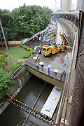 XI\'AN, CHINA - AUGUST 12: (CHINA OUT) <br /> <br /> Bus Gets Submerged In Water At Tunnel <br /> <br /> A recovery vehicle stops near a bus submerged in water on August 12, 2014 in Xi\'an, Shaanxi province of China. Torrential rains hit Xi\'an, which caused more and more standing waters on Xi\'an, Shaanxi province of China. <br /> ©Exclusivepix
