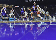 Guard Kamau Stokes #3 of the Kansas State Wildcats drives to the basket against gurad Jaylen Fisher #0 of the TCU Horned Frogs during the second half at Bramlage Coliseum in Manhattan, Kansas.