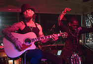TAMPA, FL - JANUARY 31: Multi-platinum recording artist, television personality and radio host Dave Navarro performs with J-Mello at the Rock-N-Babes Party with Dave Navarro and Playboy Playmates at the Hula Bay Club on January 31, 2009 in Tampa, Florida.  (Photo by Matt Stroshane/Wire Image for BrandIT Group) *** Local Caption ***