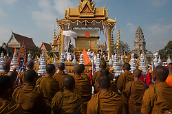 © Licensed to London News Pictures. 01/02/2013. Location, Cambodia.  Monks pray next to the Coffin of Late former King Norodom Sihanouk as part of his royal funeral procession ahead of his Feb. 4, cremation Friday, Feb. 1, 2013, in Phnom Penh, Cambodia.  Photo credit : Charles Fox/LNP