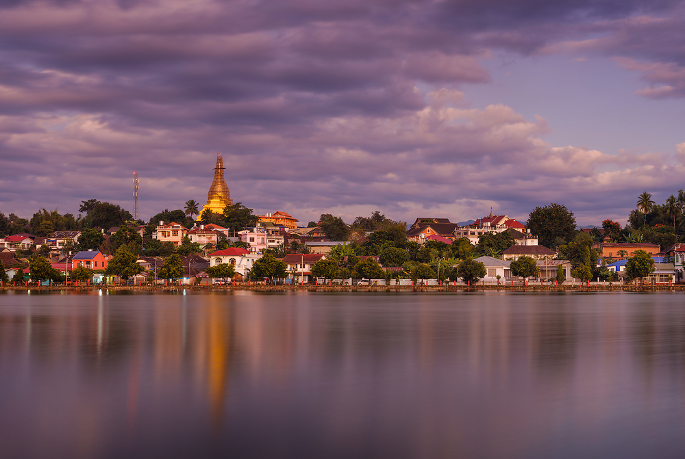 KYAING TONG, MYANMAR - CIRCA DECEMBER 2017:  View of lake Nong Tung and Wat Noi Naw in Kyaing Tong at sunset.