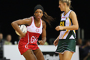England's Eboni Beckford-Chambers, left, grabs possession of the ball ahead of South Africa's Maryka Holzhausen in the New World Quad series netball match, Claudelands Arena, Hamilton, New Zealand, Thursday, November 01, 2012. Credit:NINZ / Dianne Manson.