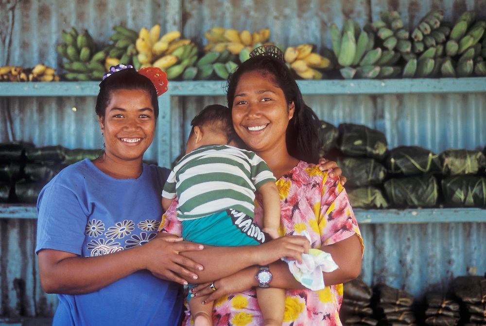 Chuuk, Micronesia: women & baby in roadside produce stand on Weno Island.
