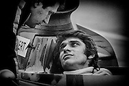 1971 United States Grand Prix winner, Francois Cevert listens intently to ELF Team Tyrrell-Ford designer Derek Gardner discuss his ideas as they try to find the best compromise for the suspension set-up of the new ELF Team Tyrrell-Ford 005 during the 1972 United States Grand Prix in Watkins Glen, NY. <br />