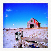 Alternative energy windmills soar above farmland Sunday, January 1, 2012, in Bridgewater, IA...Photo by Khue Bui