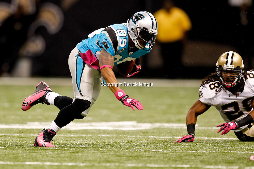 October 3, 2010; New Orleans, LA, USA; Carolina Panthers wide receiver Steve Smith (89) runs away from New Orleans Saints safety Usama Young (28) during a game at the Louisiana Superdome. The Saints defeated the Panthers 16-14. Mandatory Credit: Derick E. Hingle