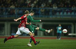 Milivoje Novakovic (11) of Slovenia hit the ball and score for Slovenia during the UEFA Friendly match between national teams of Slovenia and Denmark at the Stadium on February 6, 2008 in Nova Gorica, Slovenia. Slovenia lost 2:1. (Photo by Vid Ponikvar / Sportal Images).