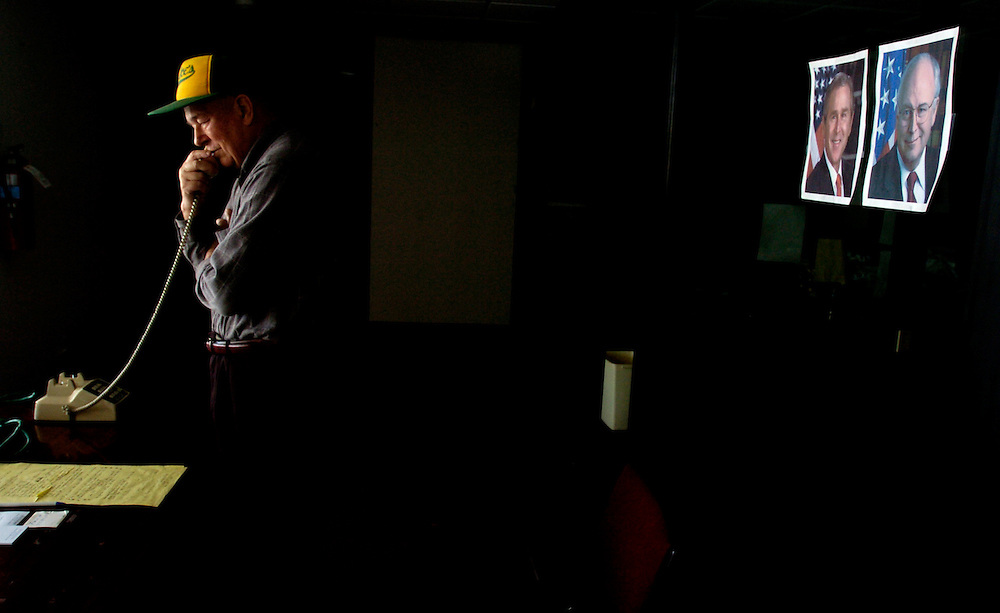 """Carville, Peck"""" Foster, co-chairman of the York County Republican Campaign, stands in a dark, empty Victory 04 Center while taking a last minute call from a poll watcher, Wednesday November 3, 2004. Local Republicans cleaned out the Victory 04 Bush/Cheney headquarters on South Queen Street Wednesday morning. John Pavoncello photo"""