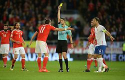 Gareth Bale of Wales is shown a yellow card. - Mandatory by-line: Alex James/JMP - 12/11/2016 - FOOTBALL - Cardiff City Stadium - Cardiff, United Kingdom - Wales v Serbia - FIFA European World Cup Qualifiers