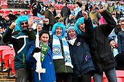 Manchester City fans in blue wigs ready to cheer their team on before the EFL Cup Final match between Arsenal and Manchester City at Wembley Stadium, London, England on 25 February 2018. Picture by Graham Hunt.