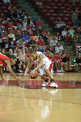 09 December 2006: Tiffany Hudson reaches for a loose ball. In a non-conference game, the Redhawks of Miami (Ohio) were defeated by the Redbirds at Redbird Arena in Normal Illinois on the campus of Illinois State University.<br />